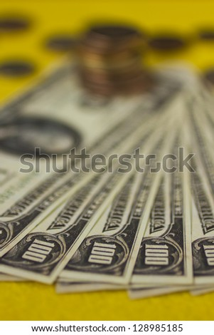 Money on a table - bills and coins. - stock photo