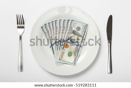 Money on a white plate on a white background, top view