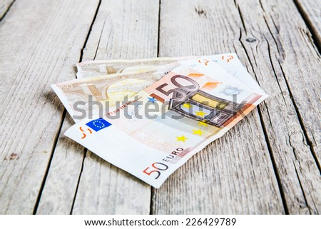 money on a wooden background