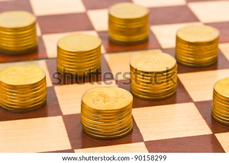 Money on chess board - concept business background - stock photo