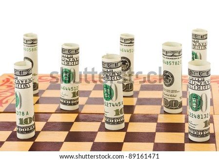 Money on chess board isolated on white background - stock photo