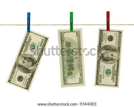 Money on clothespins, isolated on white background