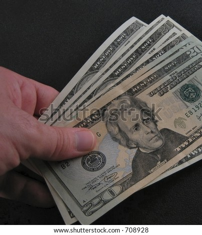 money on hand - stock photo