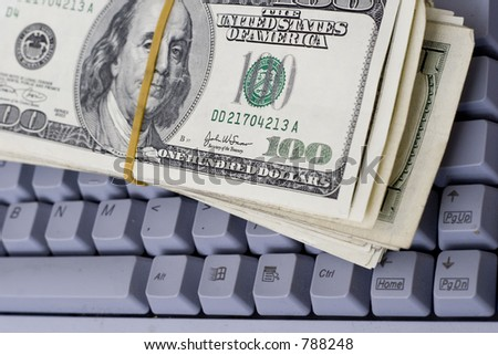 money on keyboard - stock photo