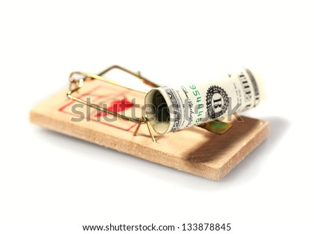 Money on mouse trap isolated on white - stock photo