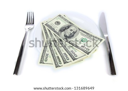 Money on plate isolated on white