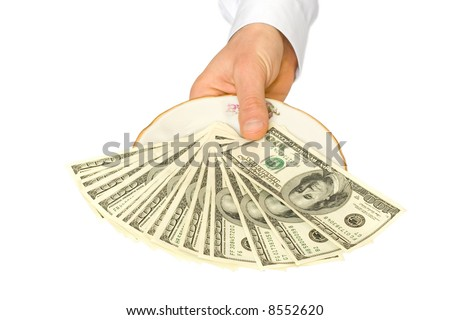 money on plate with hand
