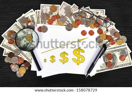 money on table and paper with chart - stock photo