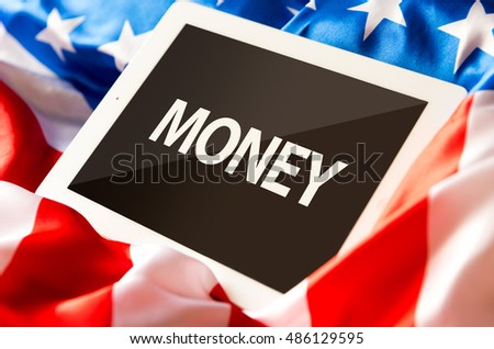 Money on tablet and the US flag