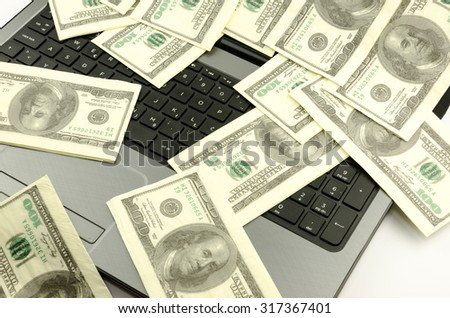 Money on the keyboard - stock photo