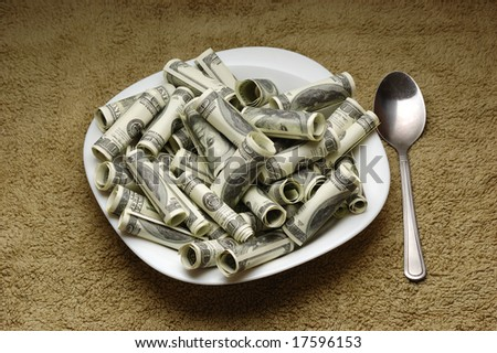 money on the plate - stock photo
