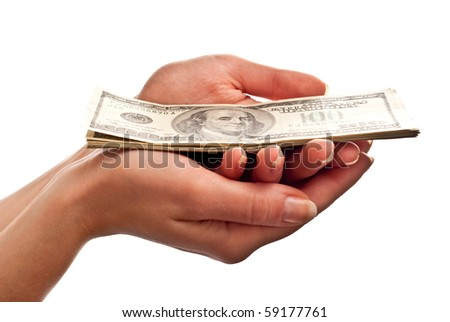 Money on woman's hand isolated on white background - stock photo