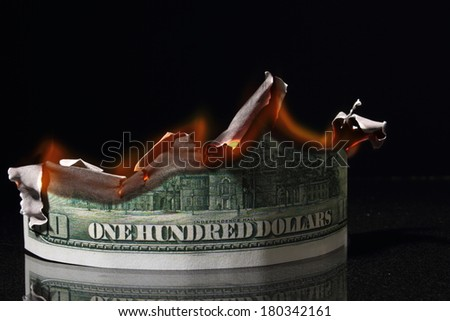money, One hundred dollars in fire, burning dollar, ashes - stock photo