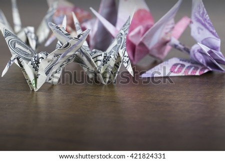 Money origami birds with lower copy space - stock photo