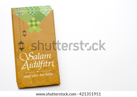 "Money  Packet for Ramadan and Ramadan and Eid Fitr Celebration. ""Selamat Hari Raya"" is translate in English means ""Eid al-Fitr"".   - stock photo"