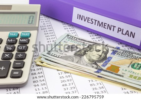 Money place on financial report with purple binder of investment plan,  concept for saving fund and return on investment - stock photo