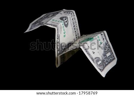 Money plane isolated on black background - stock photo
