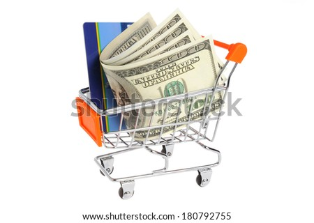 Money, plastic card in shopping cart isolated on white background