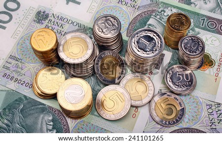 Money polish banknotes and coins - stock photo