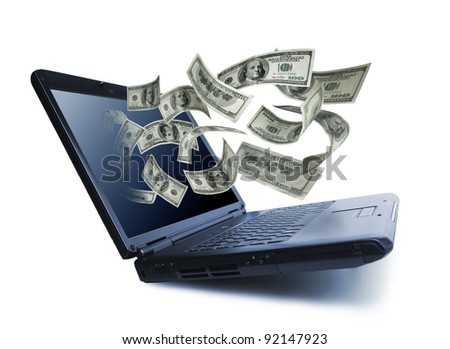Money pouring out from a notebook computer - stock photo