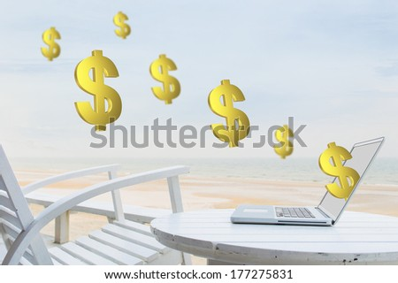 Money pouring out from laptop - stock photo