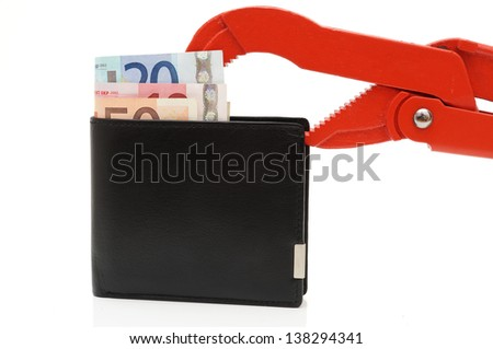 money problems with wallet and pipe Wrench isolated