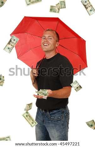 Money rains on a handsome man with an umbrella - stock photo