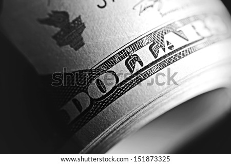 Money roll with US dollars. Black and white style. - stock photo