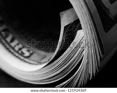 Money roll with US dollars. Macro image. - stock photo