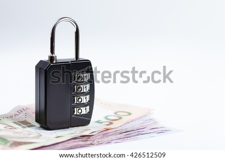 Money safety, stability concept image. Lock over ukrainians hryvnias banknotes - stock photo