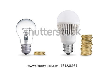 Money saved in different kinds of light bulbs. Isolated on white - stock photo