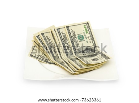 Money scattered on a plate isolated on white background