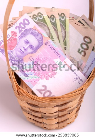 money set in a basket - stock photo
