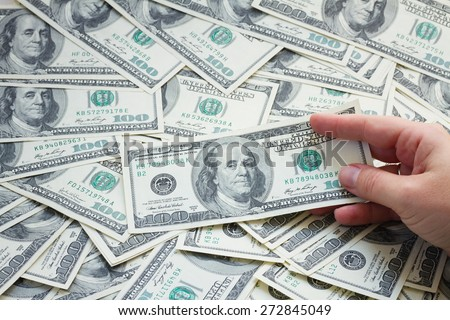 money - someones hand holding american 100 dollar banknotes  background - stock photo