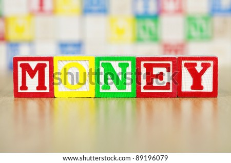 Money Spelled Out in Alphabet Building Blocks - stock photo