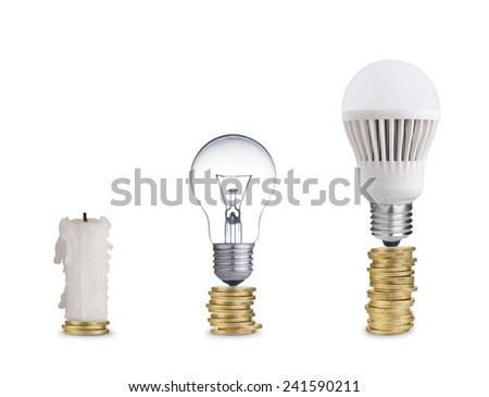 money spent on different light bulbs and candle - stock photo