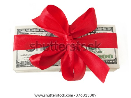 Money stack with red bow isolated on white background. Money gift concept. Money bonus concept - stock photo