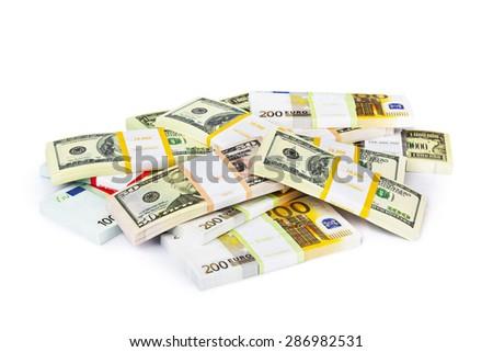 Money stacks isolated on white background - stock photo