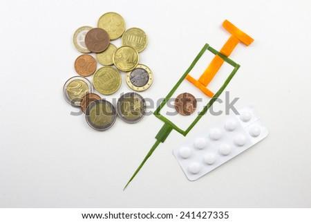 Money - syringe - tablets - stock photo
