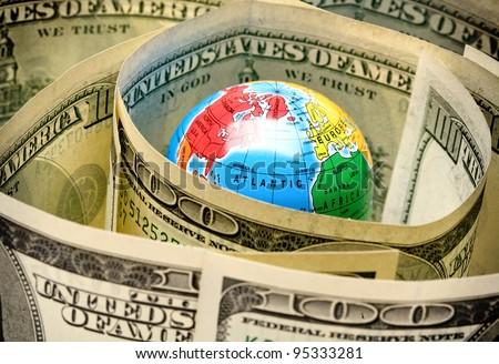 money taken over the world into a tight knot - stock photo
