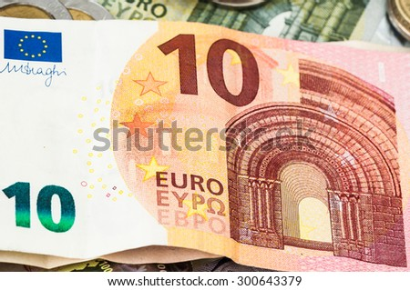 Money ten Euro Bill one and two Euro Coins - stock photo