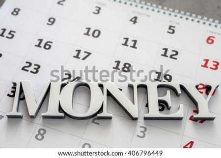 Money text over calendar background
