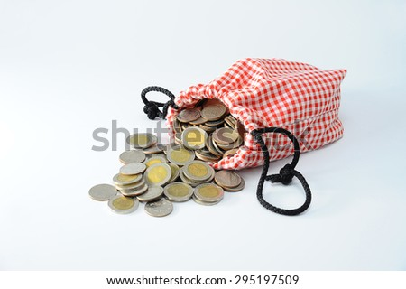 money, Thailand Baht Coins poured out of the bag Cotton Scots, Isolate - stock photo
