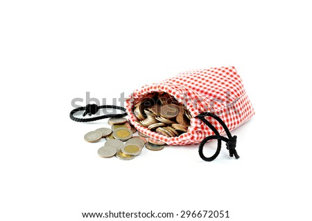 money,Thailand Baht Coins poured out of the bag Cotton Scots, Isolate - stock photo
