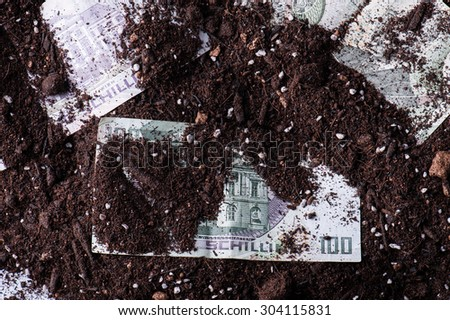 Money that has been buried in the soil