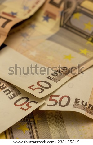 Money, three Euro banknotes in portrait format.