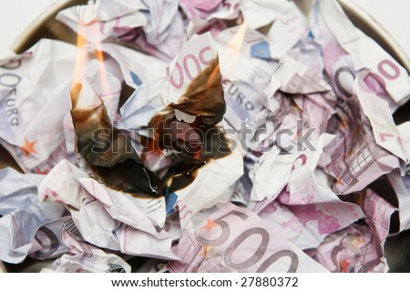 Money to burn - stock photo