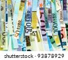 Money to burn - banknotes cut with a paper shredder - stock photo