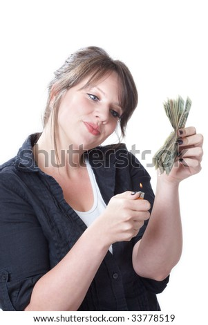 Money to burn; woman ready to light a stack of money on file; isolated on a white background. - stock photo