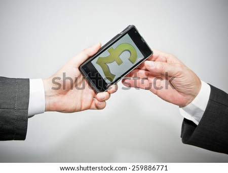 Money transfer in pounds with mobile phone concept, close up - stock photo